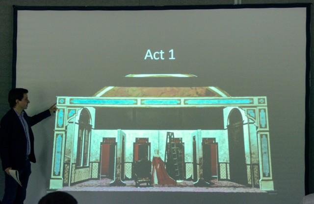 Director David Paul describing the set model photo to the FIGARO cast